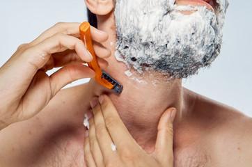 Man in foam shaving, portrait, close-up
