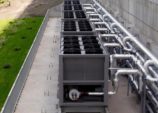 Air chiller. Sets of cooling towers in data center building.