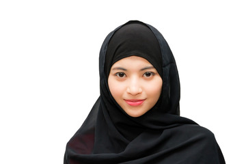 Portrait of beautiful young muslim woman with headscarf on a white background.