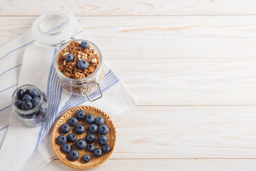 healthy breakfast homemade baked granola or muesli with fresh blueberries white background