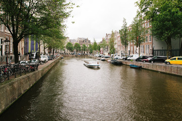 NETHERLANDS, AMSTERDAM-  Veiw on the city busy streets and people riding their bikes