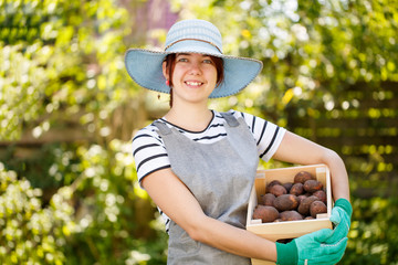 Young female farmer in hat
