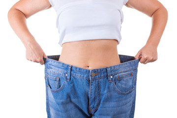Diet Concept. Slim Women in Big Jeans Showing Successful Weight Loss