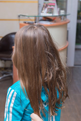 Foto op Aluminium Kapsalon Haircut and the build-up of multicolored strands