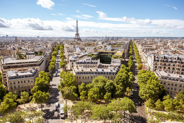 Papiers peints Paris Aerial wide angle cityscape view on the beautiful buildings and avenues with Eiffel tower on the background during the sunny day in Paris