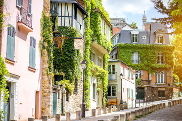 Cityscape view on the beautiful street with green buildings on Monmartre hill in Paris