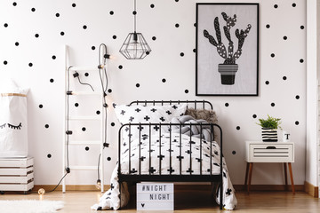 Monochromatic kids room with plant