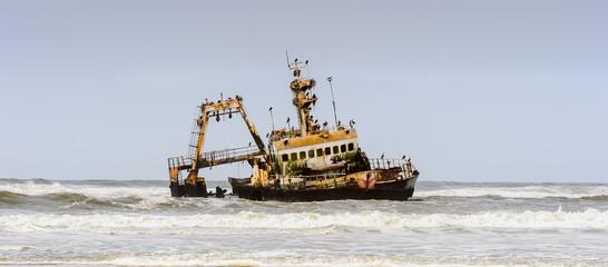 Damaged abandoned ship at the coastline of Namibia