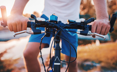 Man riding a bike in the park, close up photo. Sport and recreation concept