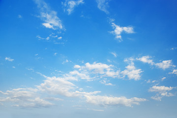 Cirrus clouds in bright blue sky.