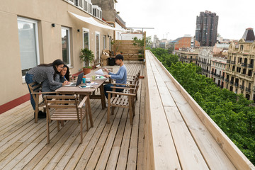 Chinese Entrepreneurs working from home at the balcony