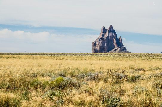 Shiprock, a volcanic rock canyon mountain, in New Mexico desert