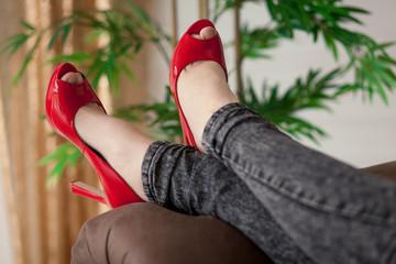Woman in red shoe relaxing