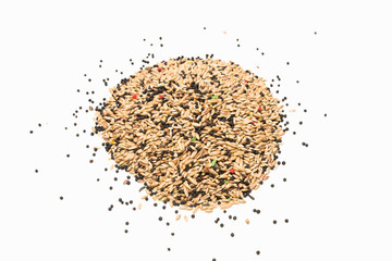 Mixed bird seed isolated on white background