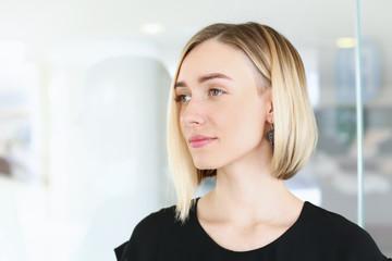 Blonde beauty businesswoman portrait look outside