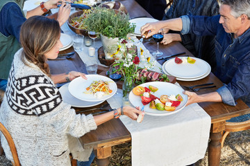 Group of friends enjoying a Farm To Table Dinner Party
