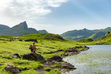 woman hiking near a mountain lake