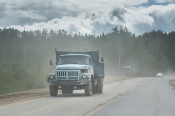 An old russian dump truck on the road