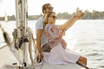 Couple talking selfie on boat