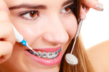 Woman with braces having dentist appointment
