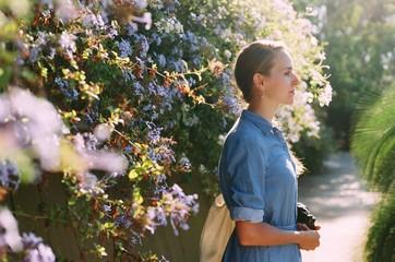 Young woman among flowering plants