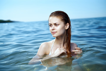 beautiful woman is swimming in the sea