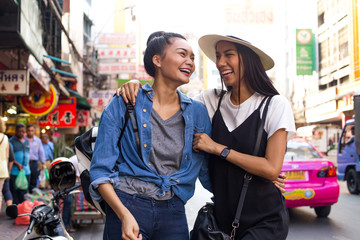Girlfriends are hanging out on the street in chinatown, Bangkok