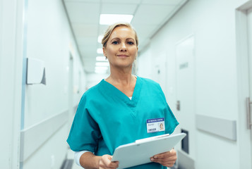 Portrait of mature female nurse working in hospital