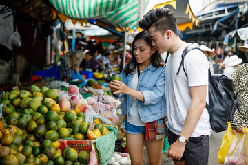 Young Couple Sightseeing at Local Market in Vietnam