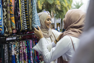 Two muslim ladies shopping for hijab