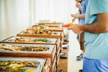 Outdoor Cuisine Culinary Buffet Dinner Catering. Group of people in all you can eat. Dining Food Celebration Party Concept. Service at business meeting, weddings. Selective focus.