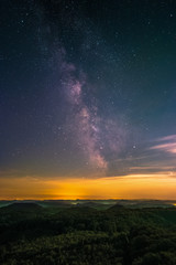 The center of the Milky Way as seen from the Luitpold Tower in the Palatinate Forest near Merzalben in Germany.