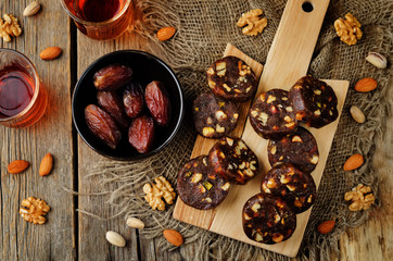Dates and nuts roll. Indian sweets. Khajoor Katri