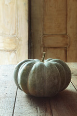 Large green gourd on kitchen table
