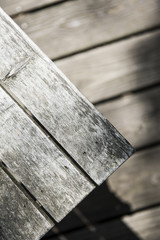 Abstract view of wooden table or bench with wooden porch backdrop.