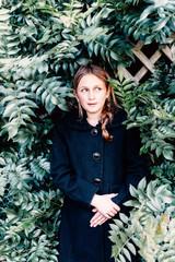 tween girl hiding in the bushes