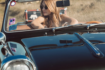 Woman Sitting in Convertible Car