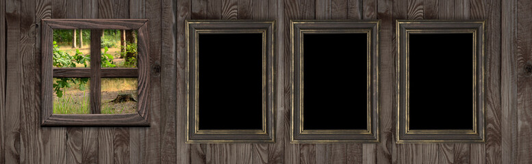 Wall with frames and forest outside the window