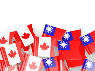 Flag pins of Canada and Taiwan isolated on white