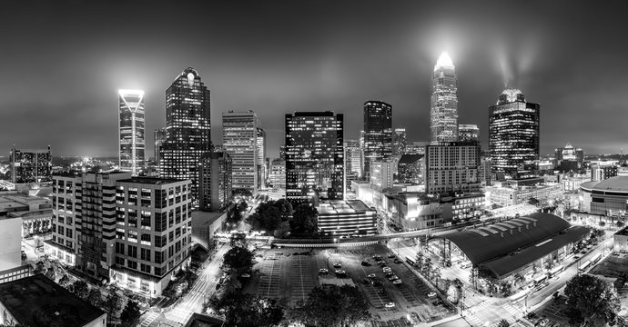 Black and white, aerial view of Charlotte, NC skyline on a foggy night. Charlotte is the largest city in the state of North Carolina and the 17th-largest city in the United States