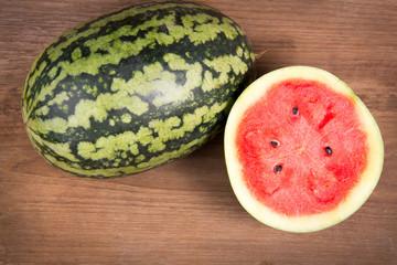 Tasty watermelon on brown wooden background