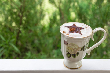 hot chocolate with green bokeh background , vintage and retro style