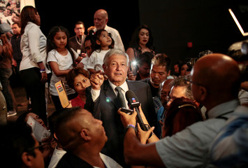 Mexico's presidential candidate Andres Manuel Lopez Obrador attends a book signing session in Los Angeles