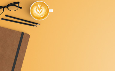 Modern workspace with coffee cup and notebook copy space on orange color background. Top view. Flat...