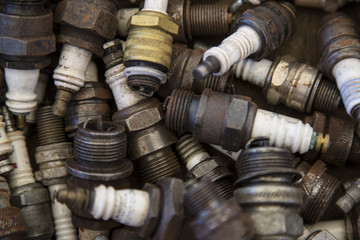 Isolated Close View of  a Collection of Old Used Spark Plugs