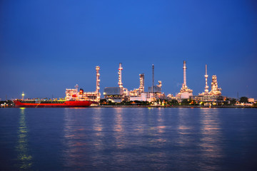 BANGKOK, THAILAND - AUGUST 13, 2017: Bangchak Oil Refinery, beside the Chao Phraya River at twilight