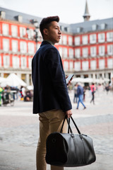 Casual young chinese man at Plaza Mayor, Madrid (Spain)