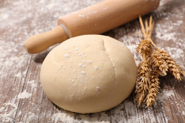 raw dough with rolling pin