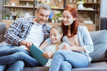 family using tablet