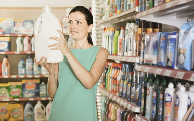 Pretty female want to buying softener in bottle